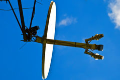 Satellite. TV antenna for mounting on a white background of blue sky day Royalty Free Stock Photo