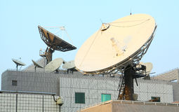 Satellite. Communications Dishes on top of TV Station stock photos