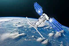 Satellite above the Earth makes measurements of the weather parameters. Sensing, research, probing, monitoring of in atmosphere El royalty free stock photo