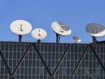 Satellite antenna. Satellite TV antenna on building roof Stock Image