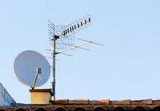 Satellite antenna. Satellite dish and tv antenna royalty free stock photo