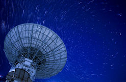Satellite Antenna with beautiful startrail in blue sky Stock Image