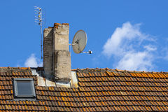 Satellite antenna on the chimney. Stock Image