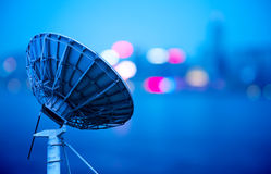Satellite Antenna. In the city night background large satellite antenna Royalty Free Stock Photos