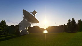 Satellite Antenna on Green Meadow, timelapse sunrise stock video footage
