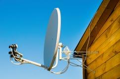 Satellite antenna. On a wooden house outdoors stock photo