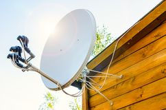 Satellite antenna. On a wooden house outdoors royalty free stock image