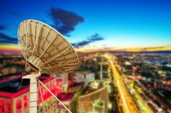 Satellite Antenna. In the tall buildings of the city royalty free stock images