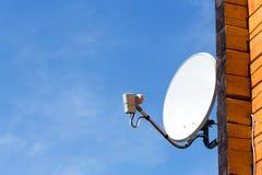 Satellite antenna on the wall Royalty Free Stock Photo