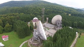 Satellite antennas  array and communications tower stock video