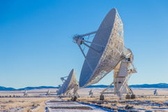 Satellite array in open field Royalty Free Stock Photo