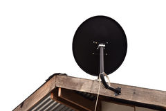 Satellite is attached on roof of the house on white background Stock Photography