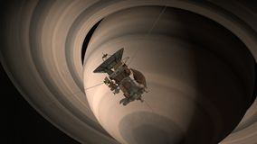 Satellite Cassini is approaching Saturn. Cassini Huygens is an unmanned spacecraft sent to the planet Saturn. CG animation. Elemen Stock Image