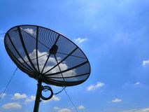 Satellite on Clear Sky and rainbow Background.Satellite dish view at day with milky way in the sky stock images