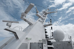 Satellite communication antenna on the top of large passenger ship. Close details of radar navigation system and communication tower Royalty Free Stock Image