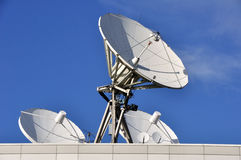 Satellite Communications Dishes. On a Roof royalty free stock photos
