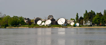 Satellite Communications Dishes. MediaPro Satellite Dishes over the lake, Buftea, Romania stock photography