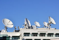 Satellite Communications Dishes. On top of TV Station royalty free stock image
