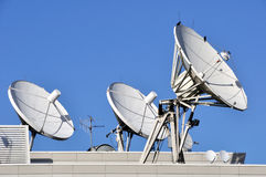 Satellite Communications Dishes. On a Roof royalty free stock photography