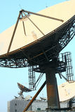 Satellite Communications Dishes. On top of TV Station stock image