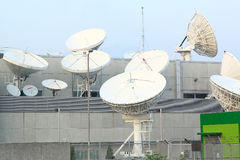 Satellite Communications Dishes. On top of TV Station stock photography