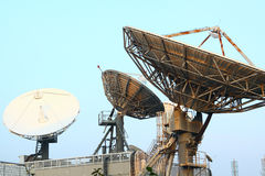 Satellite Communications Dishes. On top of TV Station royalty free stock photos