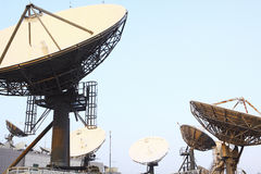 Satellite Communications Dishes. On top of TV Station royalty free stock photography