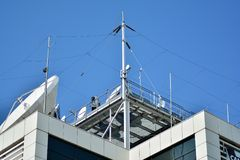 Satellite Communications Dishes on top of TV Station. Satellite dish antenna on top of the building royalty free stock images