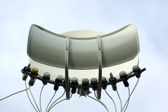 Satellite Dish. View of a toroidal multi satellite dish with 12 LNBs royalty free stock image