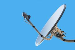 Satellite dish. The satellite television aerial on a blue background Royalty Free Stock Image