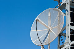 Satellite dish. On perfect sunny day with blue skies stock photo