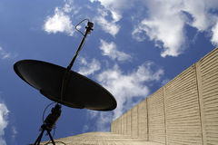 Satellite dish. On side of building royalty free stock image