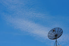 Satellite dish. With a blue sky background and clouds Royalty Free Stock Images