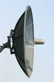 Satellite dish. Broadcasting, satellite dish on the roof, blue sky Royalty Free Stock Photo