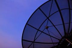 Satellite dish. Closeup with evening sky background Stock Photos