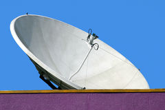 Satellite dish. On the roof blue sky Royalty Free Stock Photo
