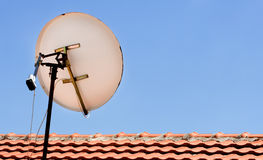 Satellite dish. On a roof stock photography