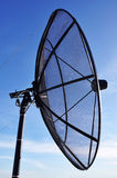 A satellite dish. On blue sky background Stock Photo