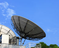 Satellite dish. With clear blue sky stock images
