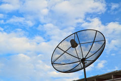 Satellite dish. With sky on roof royalty free stock images