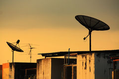 Satellite dish. On the building terrace Stock Photo