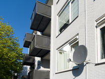 Satellite dish. On an apartment building Stock Images