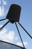 Satellite dish. On blue sky background Stock Photos