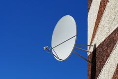Satellite dish. Satellite dish on a wall of a house Stock Photo