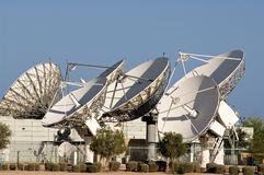 Satellite dish. Array of satellite dishes against a blue sky Royalty Free Stock Image