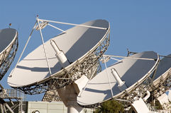Satellite dish. Array of satellite dishes against a blue sky stock photos