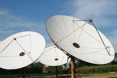 Satellite dish. Under blue sky for global communication Stock Photo