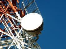 Satellite dish. A large uplink and downlink television satellite dish stock photos