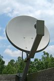Satellite dish. And cloudy blue sky background royalty free stock photos