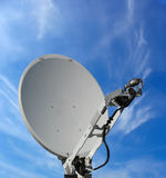 Satellite dish antenna over blue sky Royalty Free Stock Photography